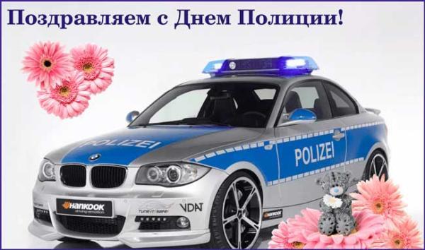 полицейская машина и цветы